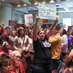 Does the DOJ have a role in monitoring school board meetings?